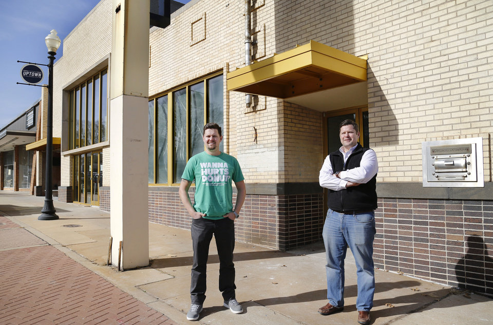 Photo -  Jess Maulsby, left, and Bruce Fraley stand outside a building at 601 NW 23, where Maulsby plans to open a Hurts Donut Co. Fraley co-owns the building.