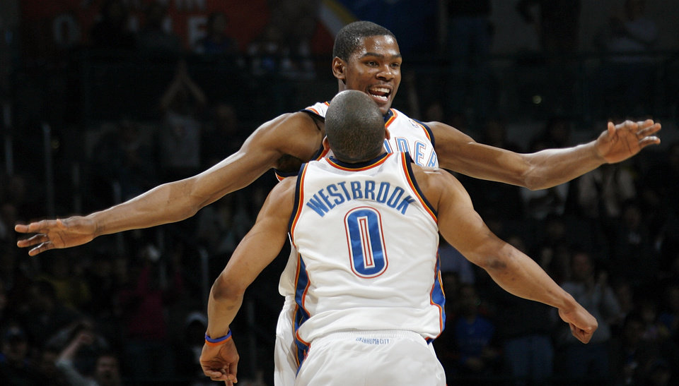 Kevin Durant (35) and Russell Westbrook (0) of Oklahoma City celebrate during the NBA basketball game between the Atlanta Hawks and the Oklahoma City Thunder at the Ford Center in Oklahoma City, Tuesday, February 2, 2010. The Thunder won, 106-99. Photo by Nate Billings, The Oklahoman