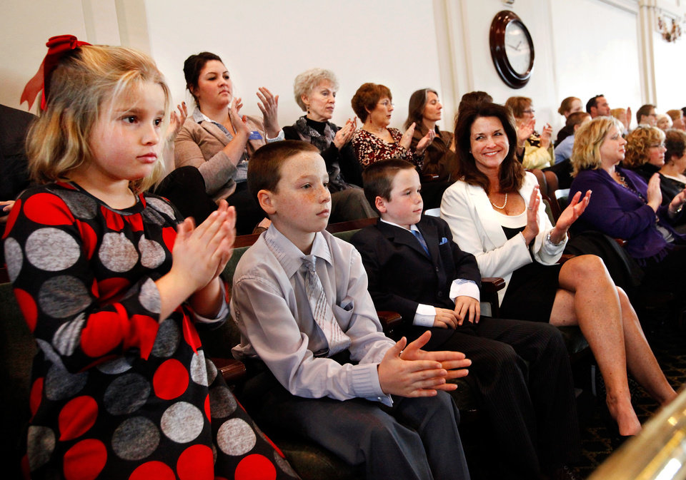 Photo - Family members of lawmakers sit in the House gallery to hear Gov. Mary Fallin deliver her 2012 State of the State address to a joint session of the Oklahoma legislature in the House Chamber on the opening day of the session, Monday, Feb, 6, 2012.  From left are Hannah Brumbaugh, 9, Jake Mulready, 10, Will Mulready, 8, and Sally Mulready. Brumbaugh is daughter of Rep. David Brumbaugh, Tulsa. The Mulready family came to the capitol as guests of  Rep. Glen Mulready, Tulsa.  Photo by Jim Beckel, The Oklahoman