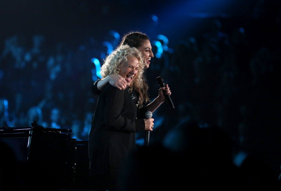 Photo - Carole King, left, and Sara Bareilles present the award for song of the year after performing at the 56th annual Grammy Awards at Staples Center on Sunday, Jan. 26, 2014, in Los Angeles. (Photo by Matt Sayles/Invision/AP)