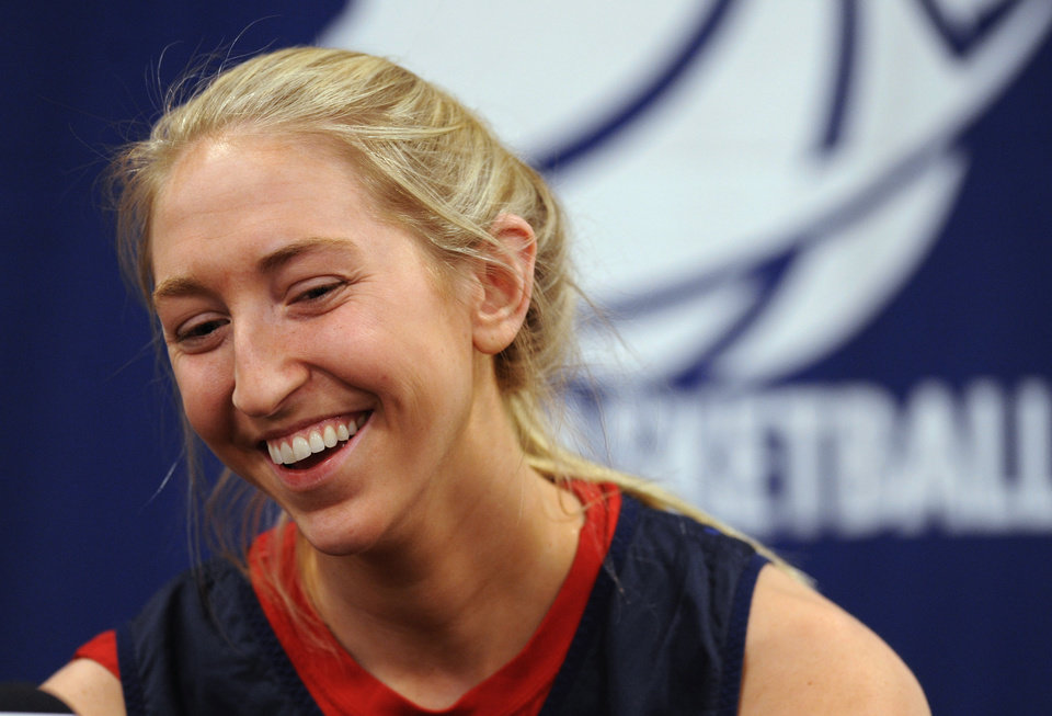 Photo - Penn's Sydney Stipanovich laughs as she answers a question during a news conference before the first round of the NCAA women's college basketball tournament, Saturday, March 22, 2014,in College Park, Md.(AP Photo/Gail Burton)