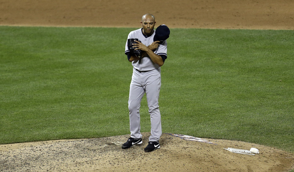 Photo - American League's Mariano Rivera, of the New York Yankees, acknowledges the crowd as he is introduced during the eighth inning of the MLB All-Star baseball game, on Tuesday, July 16, 2013, in New York. (AP Photo/Julio Cortez)