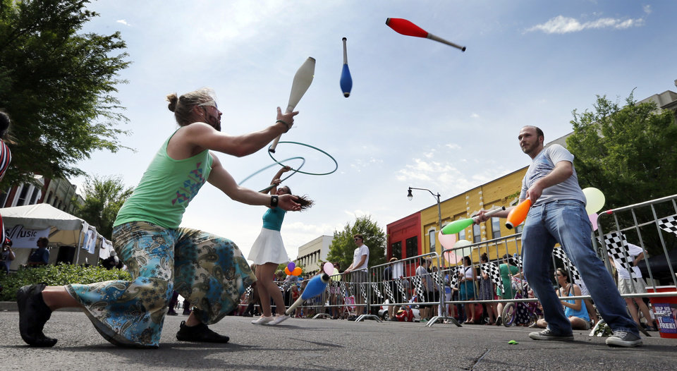 Photo - Street performers Jeremy Philo and Bryan Archer juggle during the Norman Music Festival on Saturday, April 26, 2014 in Norman, Okla.  Photo by Steve Sisney, The Oklahoman