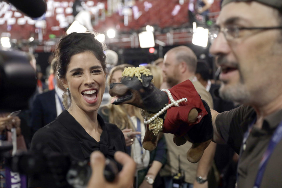 Photo - Actress Sarah Silverman laughs as she appears on the convention floor before the start of the second day session of the Democratic National Convention in Philadelphia, Tuesday, July 26, 2016. (AP Photo/Matt Rourke)