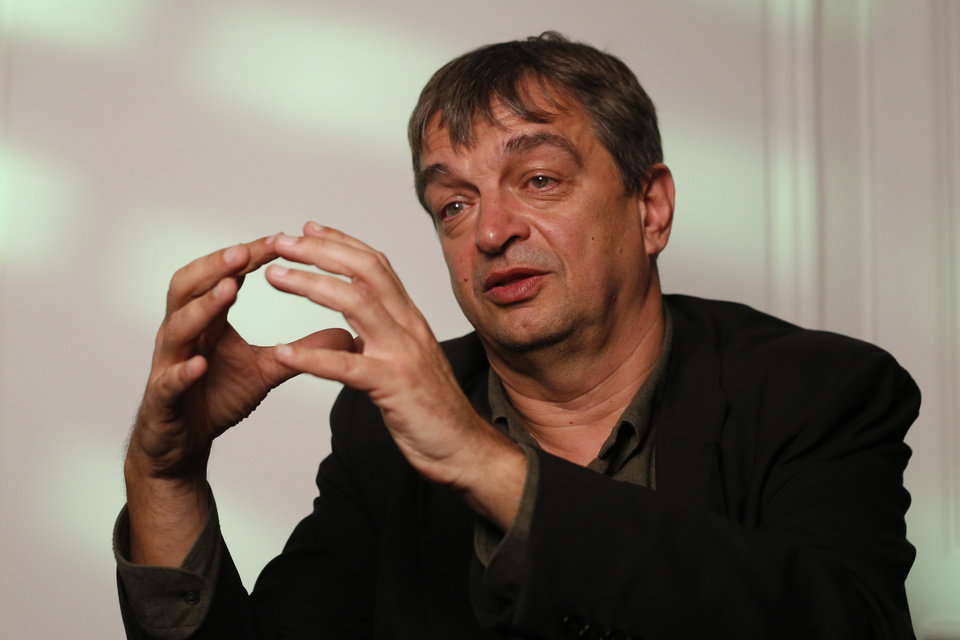 Photo - French former FIFA executive Jerome Champagne gestures during an interview with the Associated Press in Paris, Thursday, May 29, 2014. Jerome Champagne is one of the front-runners to challenge Sepp Blatter for the FIFA presidency in 2015 and refused to accept that hoping to unseat Blatter, his former boss, was a lost cause. (AP Photo/Francois Mori)