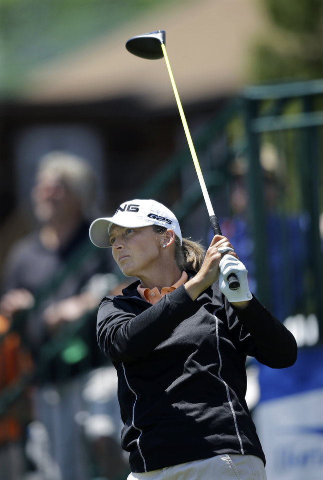Photo - Angela Stanford hits a tee shot on the first hole during the first round of the ShopRite LPGA Classic golf tournament in Galloway Township, N.J., Friday, May 30, 2014. (AP Photo/Mel Evans)