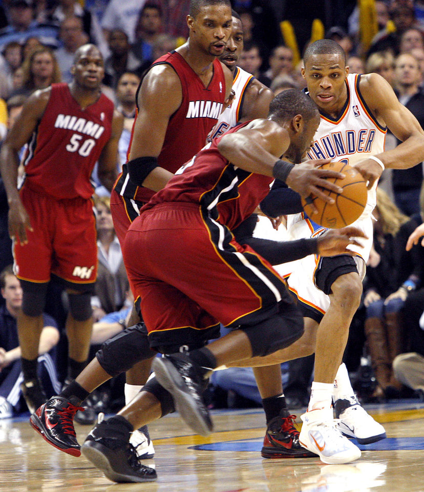 Photo - Oklahoma City's Russell Westbrook pressures Dwyane Wade and the Miami Heat defense during their NBA basketball game at the OKC Arena in Oklahoma City on Thursday, Jan. 30, 2011. The Heat beat the Thunder 108-103. Photo by John Clanton, The Oklahoman