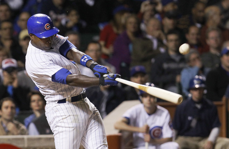 Photo -   Chicago Cubs' Alfonso Soriano hits a game tying RBI off Atlanta Braves starting pitcher Randall Delgado, scoring Tony Campana, during the sixth inning of a baseball game Tuesday, May 8, 2012, in Chicago. (AP Photo/Charles Rex Arbogast)
