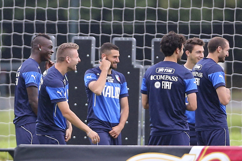 Photo - Italy squad members, from left, Mario Balotelli, Ciro Immobile, Antonio Candreva, Marco Parolo, Matteo Darmian and Giorgio Chiellini smile after applauding Balotelli for his marriage proposal to his Belgian girlfriend, during a training session in Mangaratiba, Brazil, Tuesday, June 10, 2014. Balotelli took care of some personal business before the World Cup training session, proposing to Fanny Neguesha early Tuesday morning.