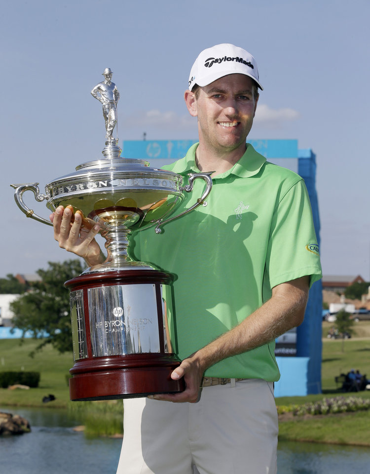 Photo - Brendon Todd holds up the trophy after winning the Byron Nelson Championship golf tournament, Sunday, May 18, 2014, in Irving, Texas. Todd finished the tourney at 14-under par, two strokes ahead of Mike Weir who finished second. (AP Photo/Tony Gutierrez)