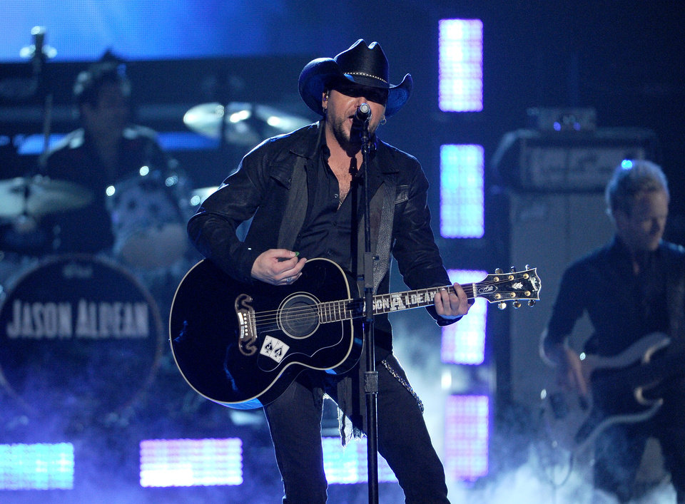 Photo - Jason Aldean performs on stage at the 49th annual Academy of Country Music Awards at the MGM Grand Garden Arena on Sunday, April 6, 2014, in Las Vegas. (Photo by Chris Pizzello/Invision/AP)