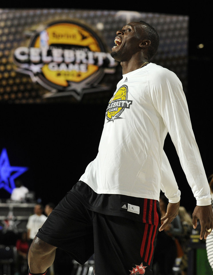 Photo - Olympic gold medalist track athlete Usain Boltm of Jamaica, warms up before the NBA All-Star celebrity basketball game, Friday, Feb. 15, 2013, in Houston. (AP Photo/Pat Sullivan)