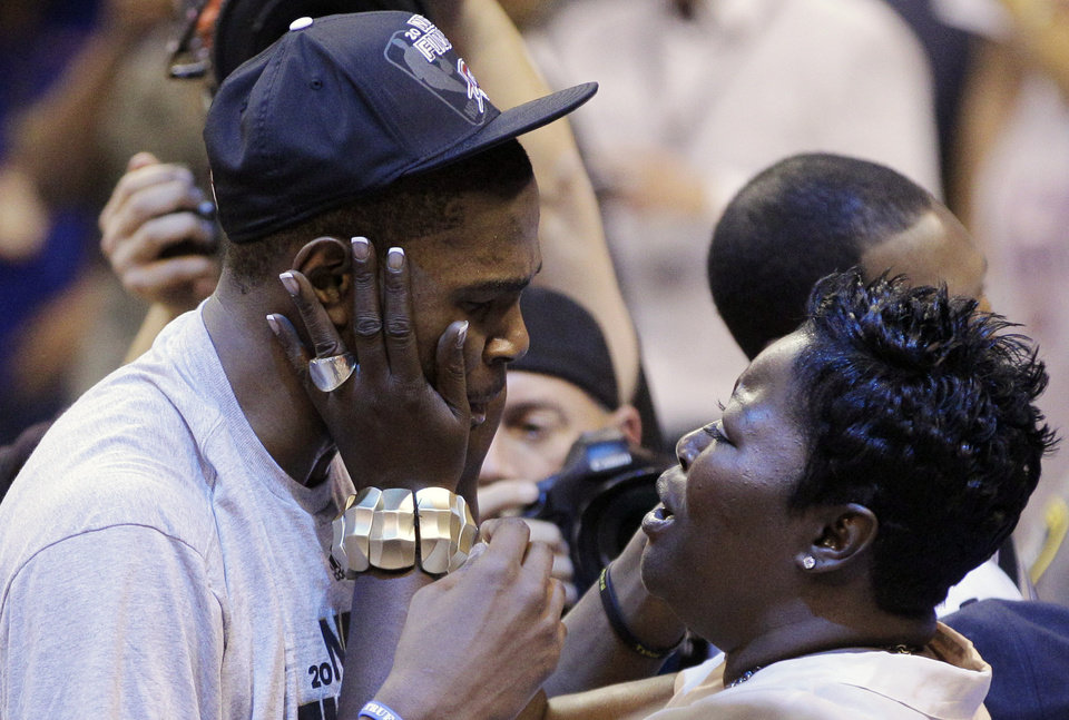 Oklahoma City Thunder small forward Kevin Durant is greeted by his mother, Wanda Pratt after Game 6 in the NBA basketball Western Conference finals against the San Antonio Spurs, Wednesday, June 6, 2012, in Oklahoma City. (AP Photo/Sue Ogrocki)