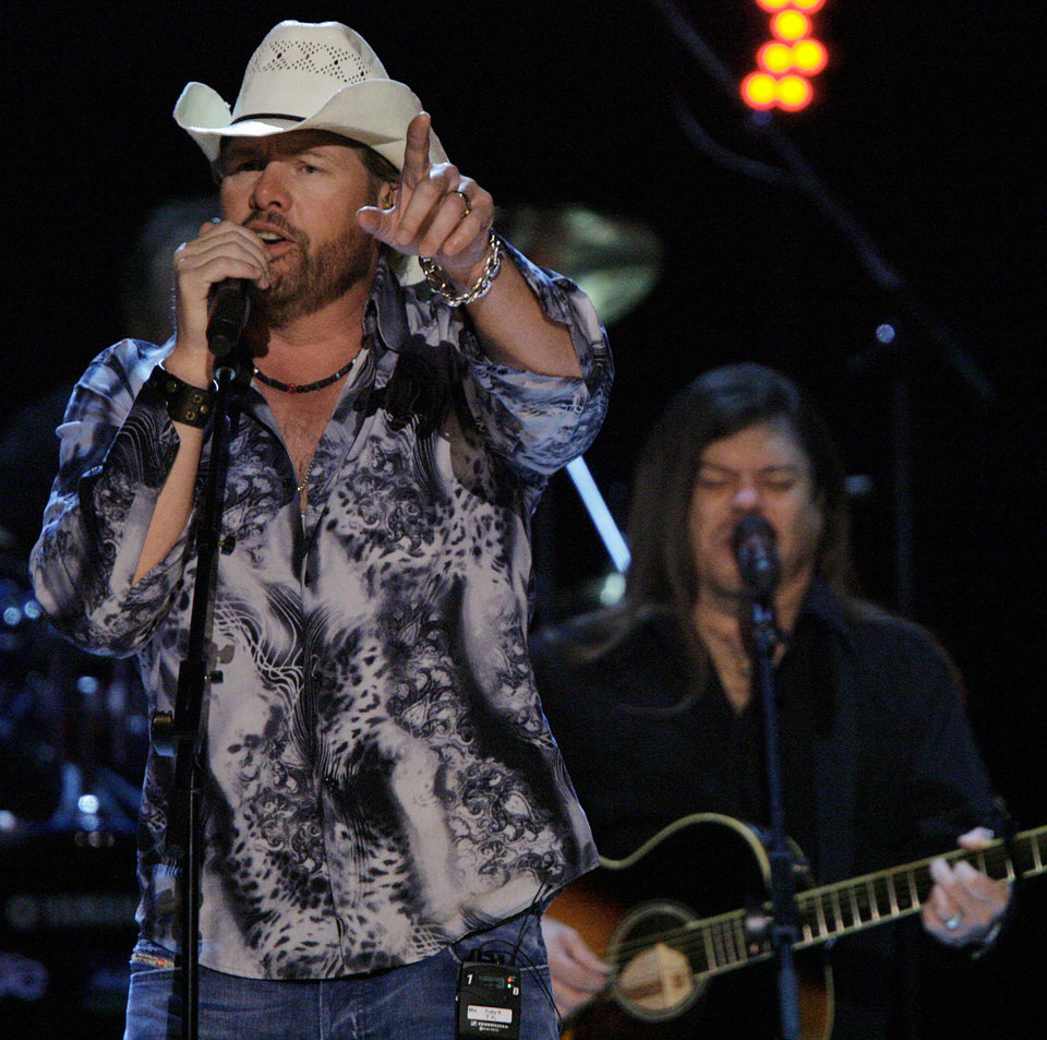 Photo - Toby Keith performs during the Centennial Spectacular to celebrate the 100th birthday of the State of Oklahoma at the Ford Center on Friday, Nov. 16, 2007, in Oklahoma City, Okla. Photo By CHRIS LANDSBERGER, The Oklahoman