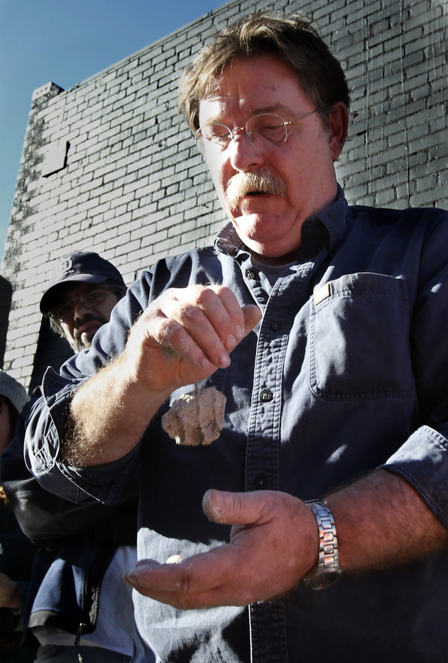 Bob Yapp shows his personal slump test for mortar as he teaches residents how to make masonry repairs on a downtown building on Saturday, Nov. 17, 2012 in Norman, Okla. Yapp is a nationally recognized historic preservation expert who is leading a workshop on masonry repair. Photo by Steve Sisney, The Oklahoman