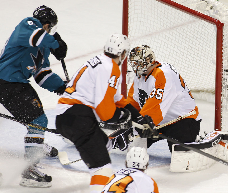 Photo - San Jose Sharks' Matt Nieto, left, scores past Philadelphia Flyers goalie Steve Mason (35) during the first period of an NHL hockey game, Monday, Feb. 3, 2014, in San Jose, Calif. (AP Photo/George Nikitin)