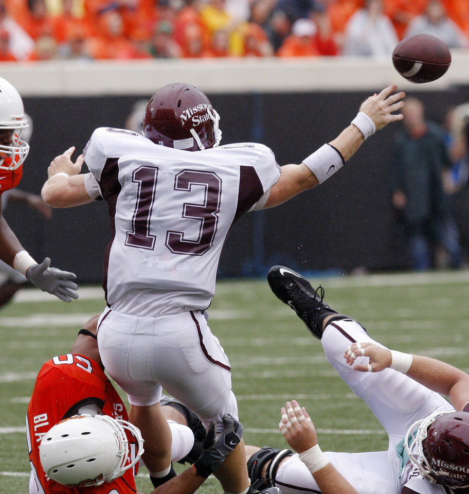Photo - Jamie Blatnick has hold of Cody Kirby as he passes at the Oklahoma State University (OSU) football game against Missouri State University (MSU) Saturday Sept. 13, 2008 at Boone Pickens Stadium in Stillwater, Okla. BY DOUG HOKE, THE OKLAHOMAN.