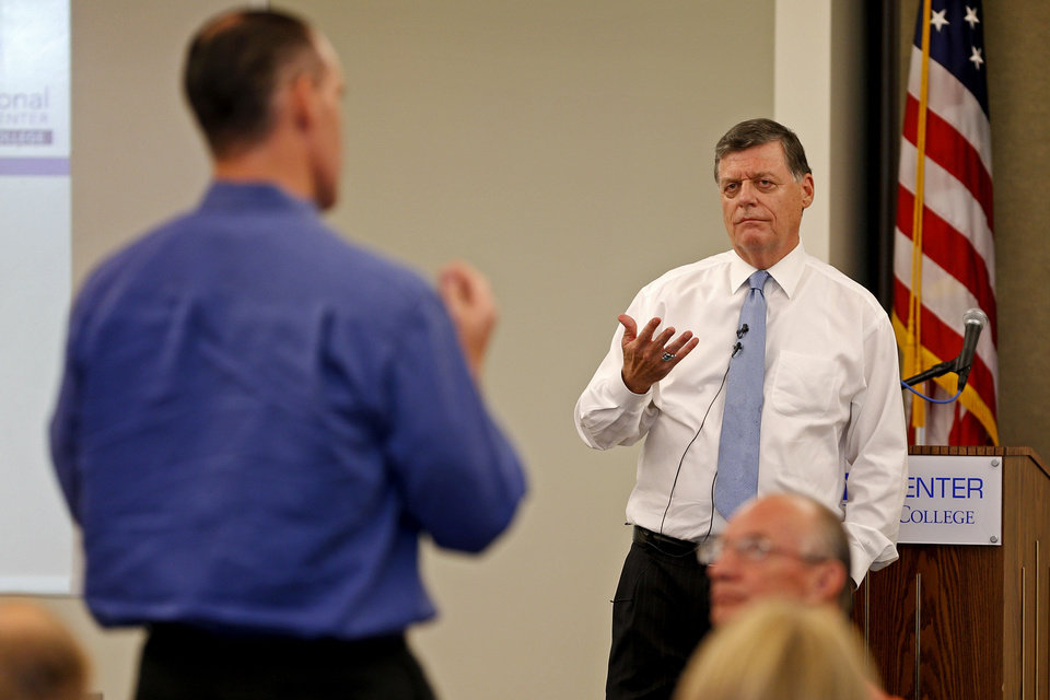 Photo - Rep. Tom Cole, R-Moore, answers a question during a town hall meeting at Rose State College in Midwest City, Tuesday, September 3, 2013. Photo by Bryan Terry, The Oklahoman  BRYAN TERRY - THE OKLAHOMAN