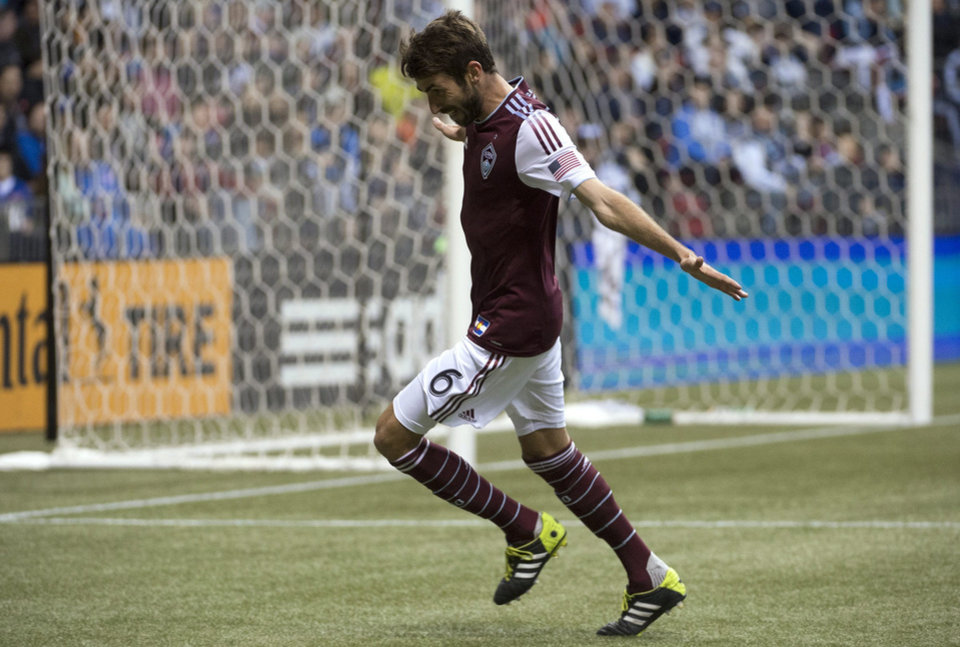 Photo - Colorado Rapids FC Jose Mari celebrates his goal against the Vancouver Whitecaps during second half of MLS soccer action in Vancouver, Canada, Saturday, April 5, 2014. (AP Photo/The Canadian Press, Jonathan Hayward)