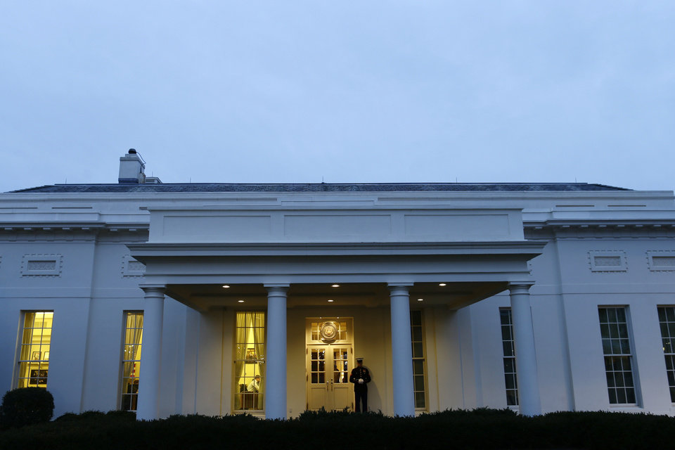 A Marine sentry stands guard, indicating that President Obama is working in the West Wing of the White House, as discussions regarding the fiscal cliff continue on Capitol Hill in Washington on Tuesday, Jan. 1, 2013. (AP Photo/Charles Dharapak)