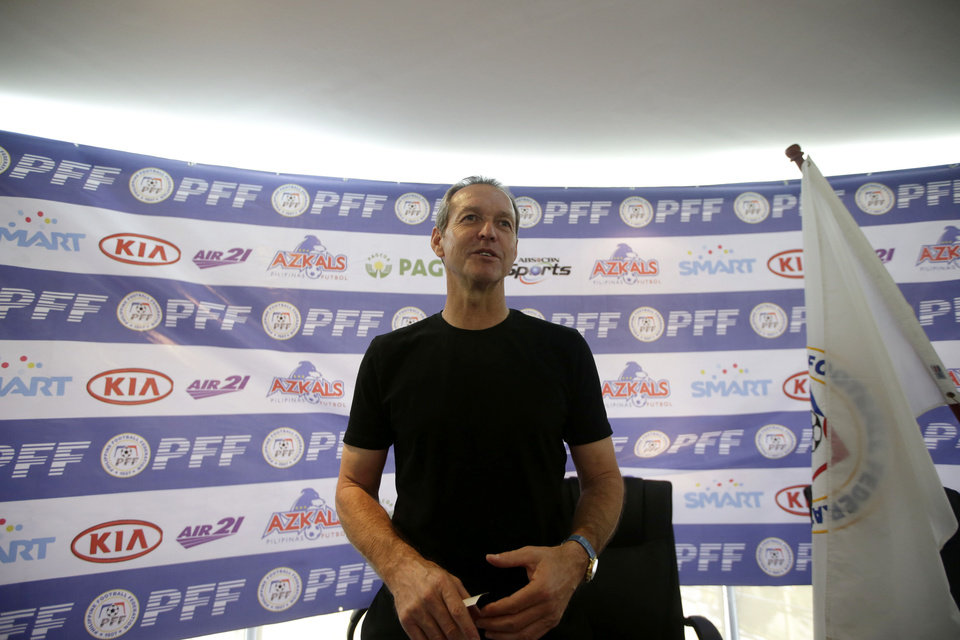 Photo - Former U.S. captain Thomas Dooley poses for photographers following his appointment as the new head coach of the Philippine national football team known as