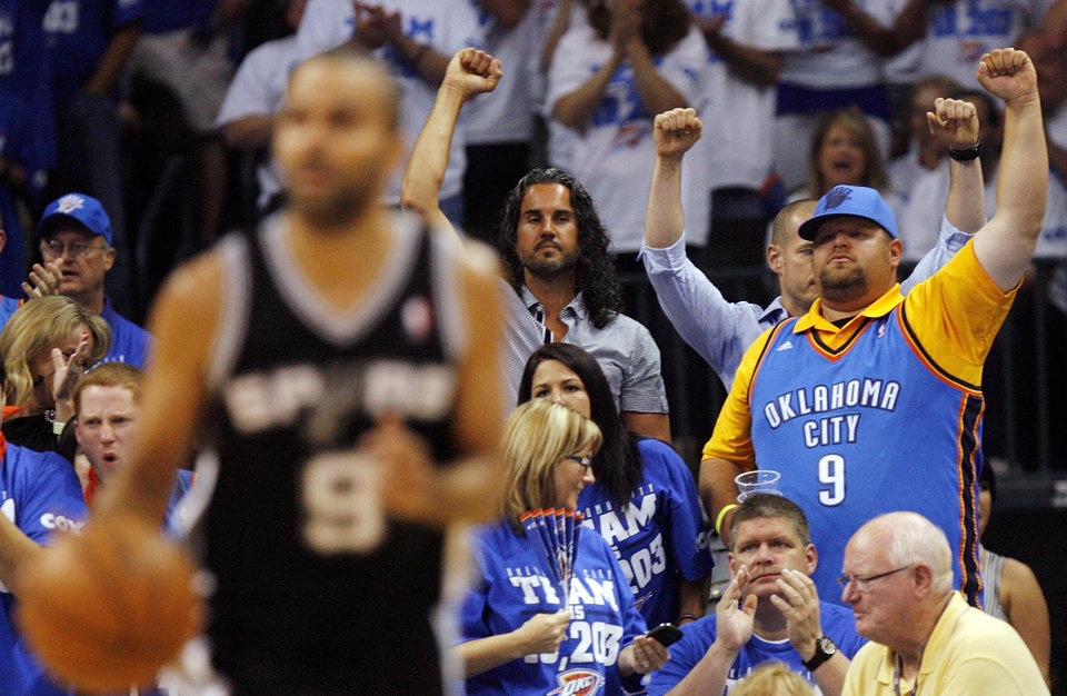 Photo - Fans cheer after a Thunder score as San Antonio's Tony Parker (9) dribbles during Game 4 of the Western Conference Finals between the Oklahoma City Thunder and the San Antonio Spurs in the NBA playoffs at the Chesapeake Energy Arena in Oklahoma City, Saturday, June 2, 2012.  Photo by Nate Billings, The Oklahoman