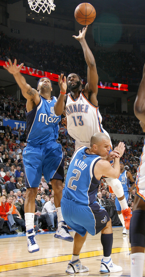 Photo - Oklahoma City's James Harden shoots the ball over Drew Gooden, left, and Jason Kidd of Dallas during the NBA basketball game between the Oklahoma City Thunder and the Dallas Mavericks at the Ford Center in Oklahoma City on Wednesday, December 16, 2009. Photo by Bryan Terry, The Oklahoman