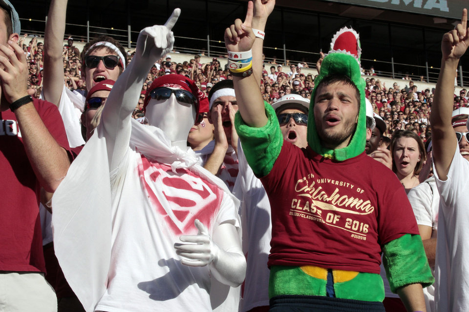 Photo - Erik Flinn and Nick Reed cheer before the college football game between the University of Oklahoma Sooners (OU) and Florida A&M Rattlers at Gaylord Family—Oklahoma Memorial Stadium in Norman, Okla., Saturday, Sept. 8, 2012. Photo by Steve Sisney, The Oklahoman