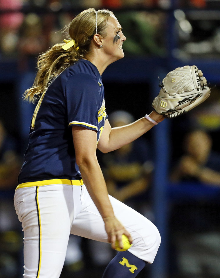 Photo - Michigan's Sara Driesenga (10) pitches  during an NCAA softball game in the Women's College World Series between Oklahoma and Michigan at ASA Hall of Fame Stadium, Thursday, May 30, 2013. Photo by Nate Billings, The Oklahoman