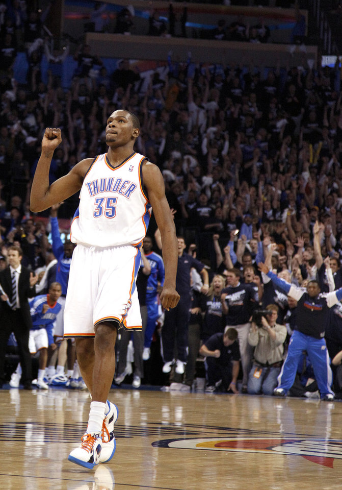 Photo - Oklahoma City's Kevin Durant (35) reacts after making 19-foot jumper the final minute of the NBA basketball game between the Denver Nuggets and the Oklahoma City Thunder in the first round of the NBA playoffs at the Oklahoma City Arena, Wednesday, April 27, 2011. Photo by Sarah Phipps, The Oklahoman