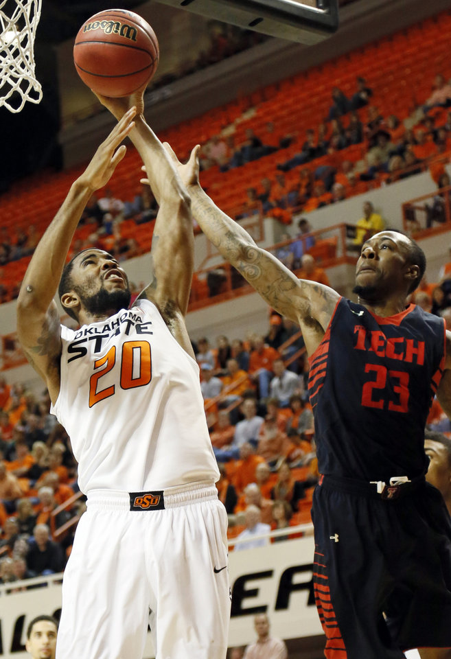 Oklahoma State\'s Michael Cobbins (20) takes a shot against Texas Tech\'s Jamal Williams Jr. (23) during a men\'s college basketball game between Oklahoma State University and Texas Tech at Gallagher-Iba Arena in Stillwater, Okla., Saturday, Jan. 19, 2013. OSU won, 79-45. Photo by Nate Billings, The Oklahoman