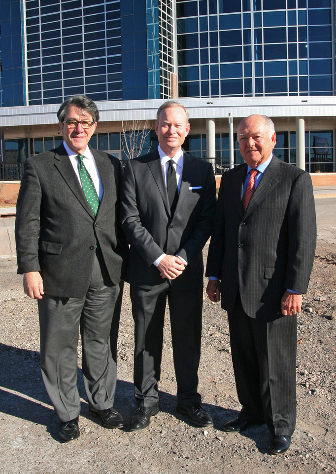 From left, American Architectural Foundation CEO Ron Bogle, Oklahoma City Mayor Mick Cornett and former Mayor Ron Norick stand Thursday in front of Chesapeake Energy Arena after Bogle announced Cornett this spring will be the recipient of a national urban design leadership award. Photo provided <strong>PROVIDED</strong>