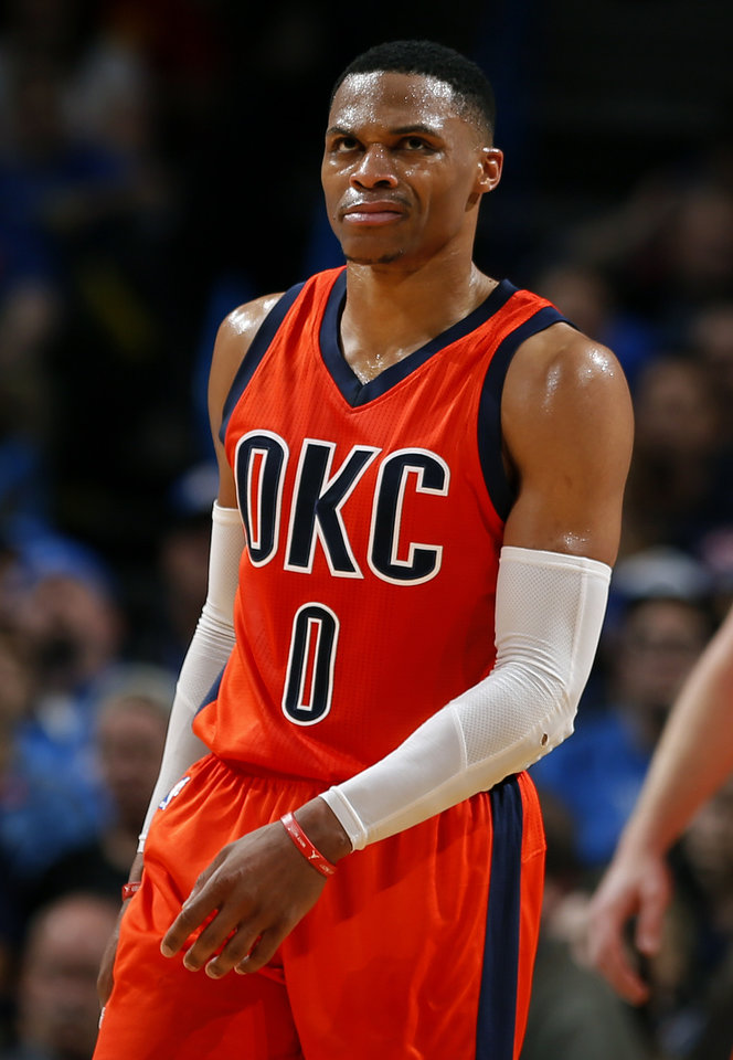 Photo - Oklahoma City's Russell Westbrook (0) reacts after a dunk during the NBA game between the Oklahoma City Thunder and the New Orleans Pelicans at the Chesapeake Energy Arena,  Sunday, Dec. 4, 2016. Photo by Sarah Phipps, The Oklahoman