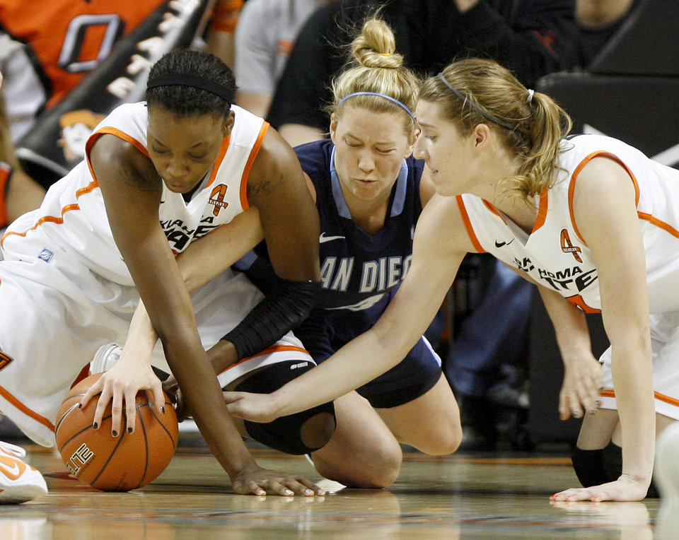 Oklahoma State's Toni Young, left, and Liz Donohoe fight for the loose ball with San Diego's Izzy Chilcott during the women's NIT semifinal college basketball game between Oklahoma State University (OSU) and San Diego at Gallagher-Iba Arena in Stillwater, Okla., Wednesday, March 28, 2012. Photo by Bryan Terry, The Oklahoman