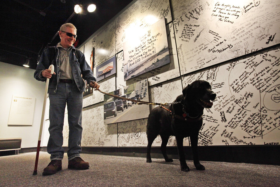 Above: Vietnam veteran Michael Stephens visits the Oklahoma City National Memorial & Museum on Friday with his guide dog, Tommy, on a tour with NewView Oklahoma.