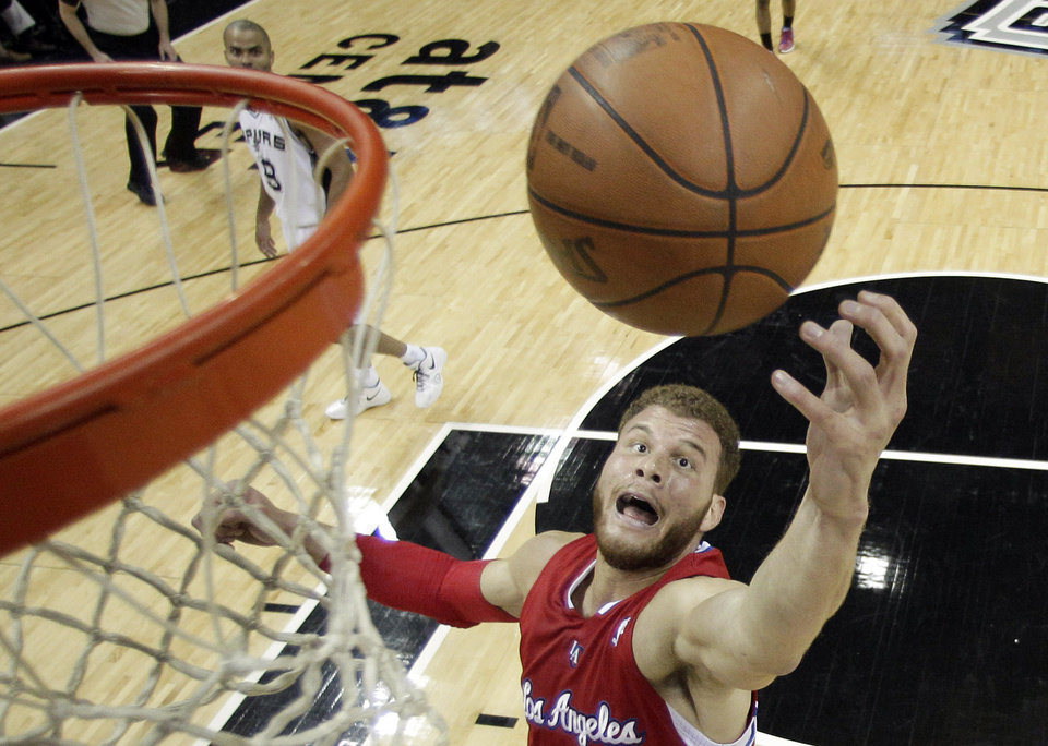 FILE - In this May 15, 2012, file photo, Los Angeles Clippers' Blake Griffin reaches for a rebound during the first quarter of Game 1 of an  NBA basketball Western Conference semifinal playoff series against the San Antonio Spurs in San Antonio. The Clippers signed Griffin to a five-year contract extension that could be worth up to $95 million, the team announced on Tuesday, July 10, 2012. (AP Photo/Eric Gay, File) ORG XMIT: NY157