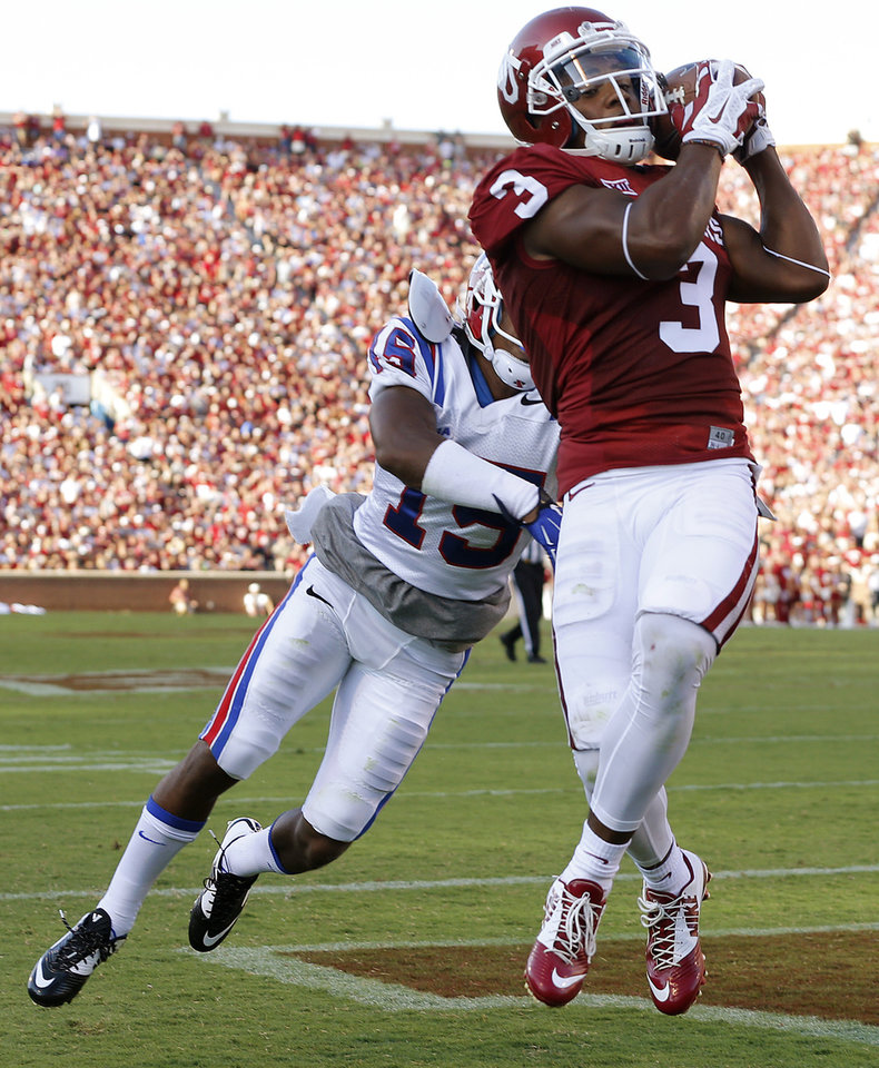 Photo - Oklahoma's Sterling Shepard (3) catches a touchdown pass in front of Louisiana Tech's Bryson Abraham (15) during a college football game between the University of Oklahoma Sooners (OU) and the Louisiana Tech Bulldogs at Gaylord Family-Oklahoma Memorial Stadium in Norman, Okla., on Saturday, Aug. 30, 2014. Photo by Bryan Terry, The Oklahoman