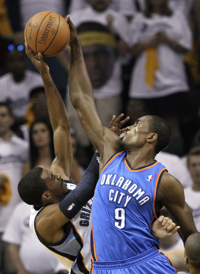 Photo - Oklahoma City Thunder forward Serge Ibaka (9) blocks a shot by Memphis Grizzlies guard Mike Conley, left, during the first half of Game 3 of a second-round NBA basketball series on Saturday, May 7, 2011, in Memphis, Tenn. (AP Photo/Lance Murphey)