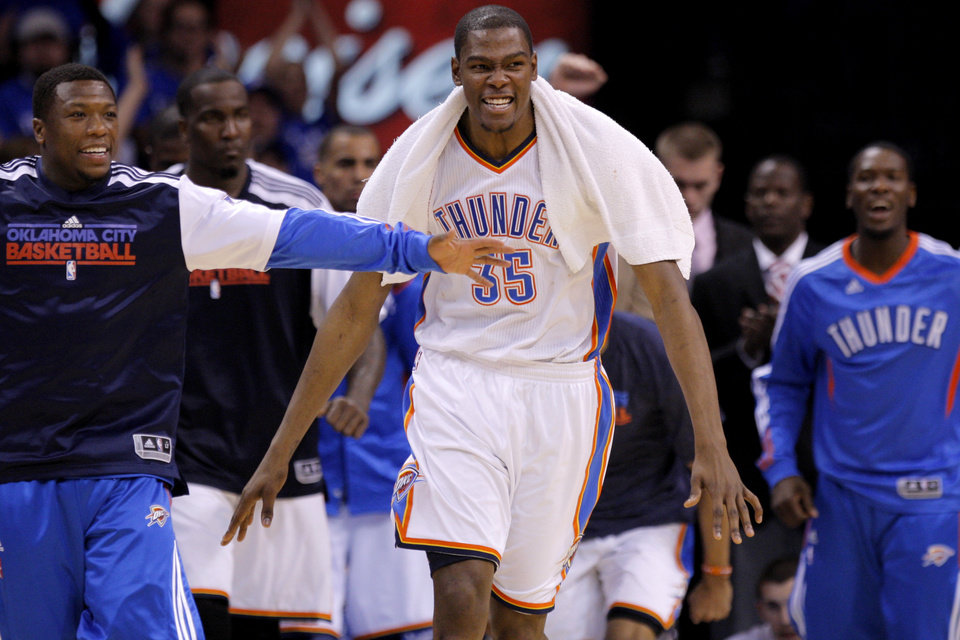 Photo - Oklahoma City's Kevin Durant (35) reacts beside Nate Robinson during game two of the Western Conference semifinals between the Memphis Grizzlies and the Oklahoma City Thunder in the NBA basketball playoffs at Oklahoma City Arena in Oklahoma City, Tuesday, May 3, 2011. Photo by Bryan Terry, The Oklahoman
