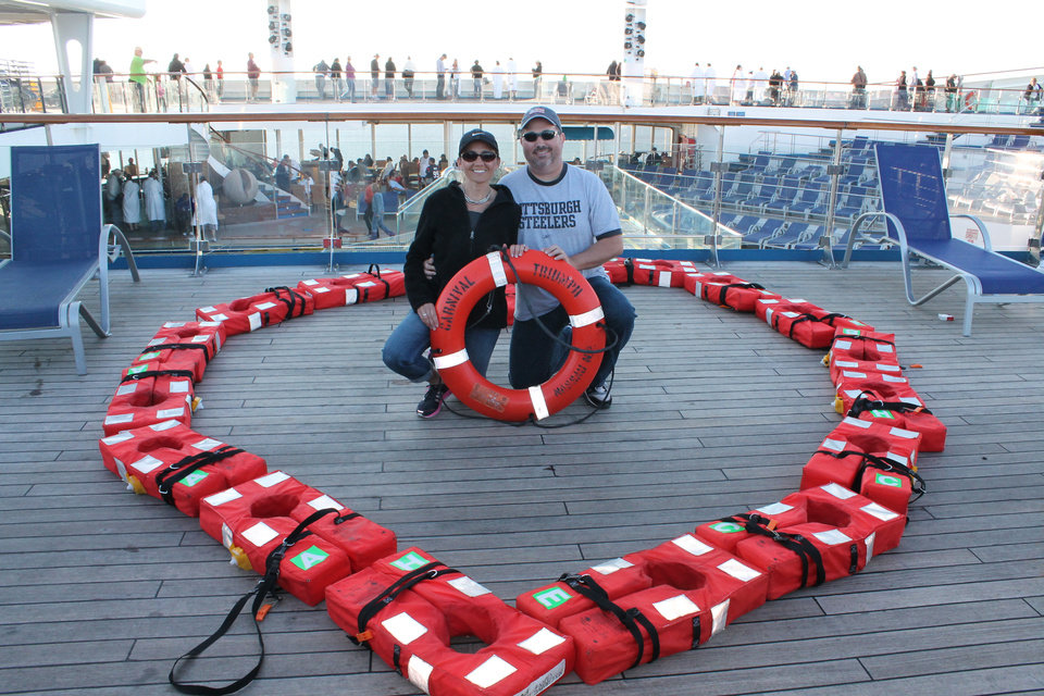 Robin and Chris Carpenter pose on the deck of the crippled cruise ship Triumph on Valentine's Day, Feb. 14. They arrived home Friday after five days of being stalled at sea. <strong> - photo provided</strong>