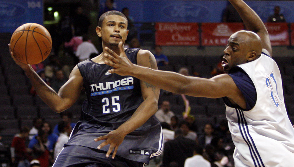 Earl Watson passes the ball around Damien Wilkins during the open practice for the Oklahoma City Thunder NBA basketball team at the Ford Center in Oklahoma City, Monday, October 20, 2008. BY NATE BILLINGS, THE OKLAHOMAN