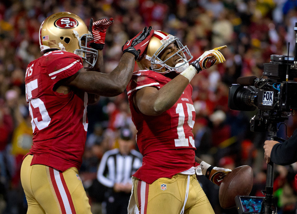 Photo - San Francisco 49ers' Michael Crabtree is congratulated by teammate Vernon Davis after scoring a touchdown in the second quarter of an NFC divisional playoff NFL football game against the Green Bay Packers on Saturday, Jan. 12, 2013, in San Francisco. (AP Photo/The Sacramento Bee, Jose Luis Villegas)
