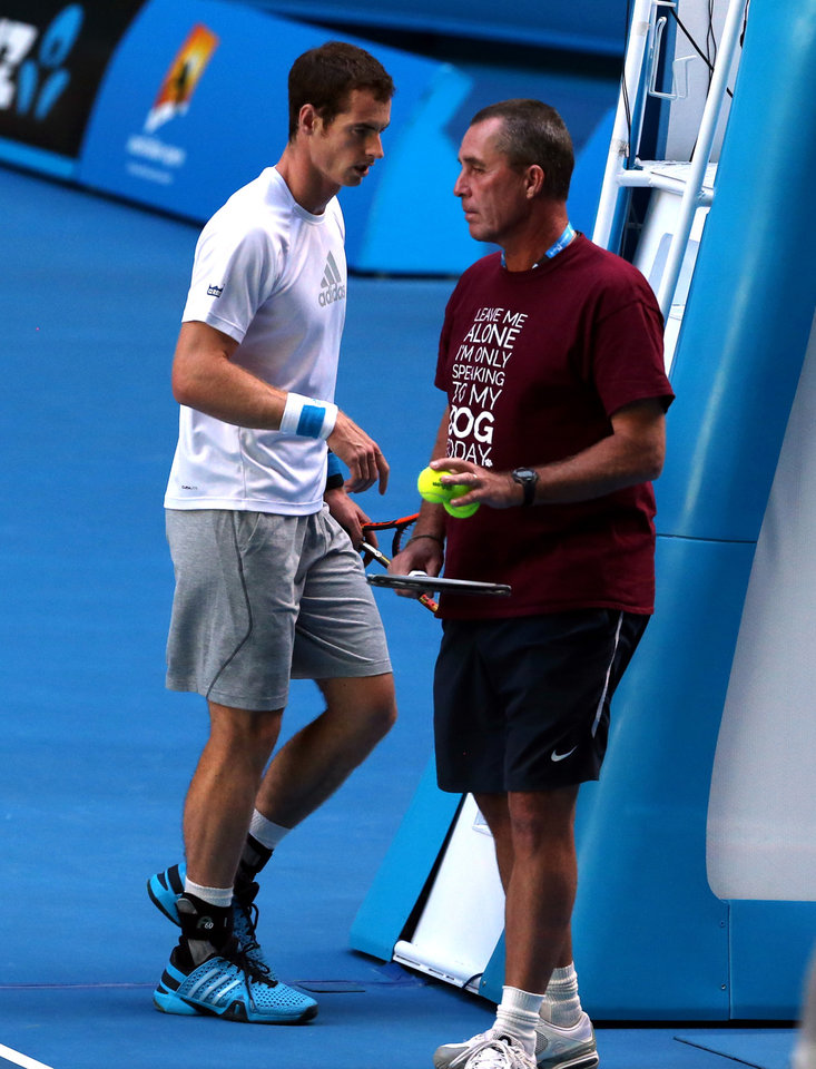 Photo - Andy Murray of Britain, left,  walks past his coach Ivan Lendl during a training session on the Rod Laver Arena, at the Australian Open tennis championship in Melbourne, Australia, Tuesday, Jan. 21, 2014.  Wimbledon champion Murray faces Roger Federer, winner of 17 Grand Slams, at the Australian Open quarterfinal Wednesday.(AP Photo/Shuji Kajiyama)