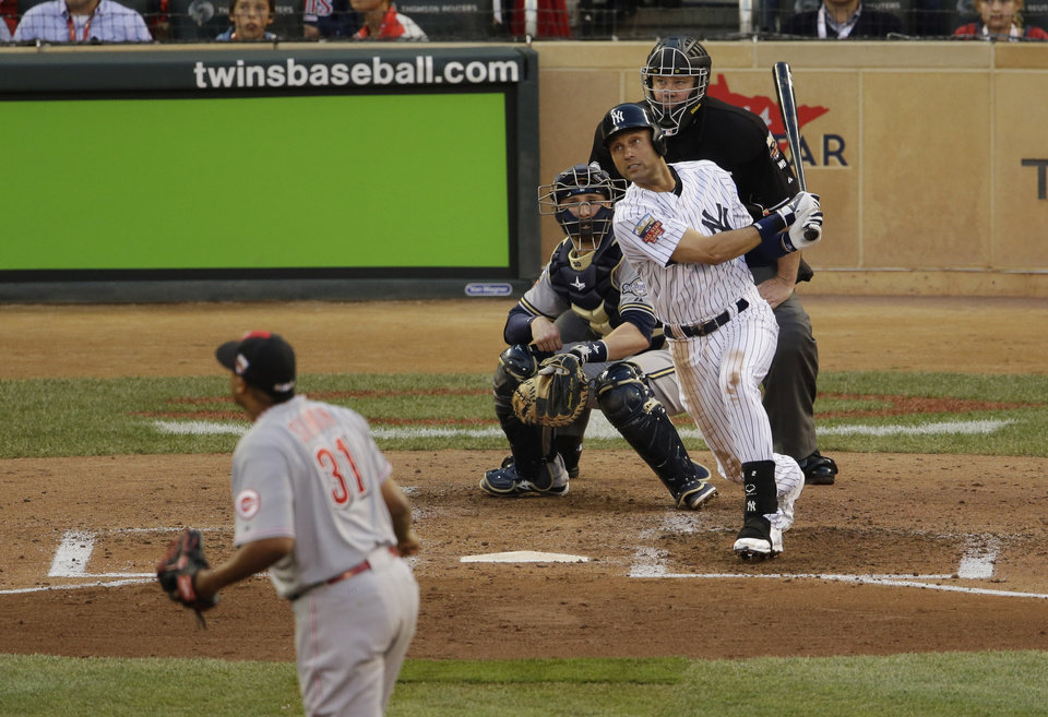 Photo - American League shortstop Derek Jeter, of the New York Yankees, singles during the third inning of the MLB All-Star baseball game, Tuesday, July 15, 2014, in Minneapolis. (AP Photo/Paul Sancya)
