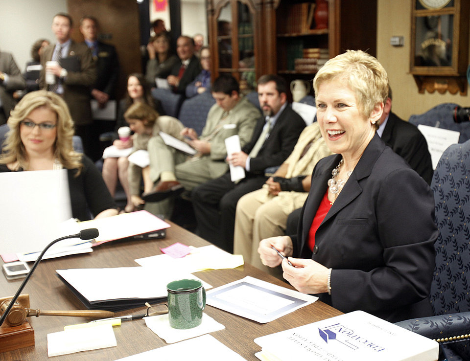 State schools Superintendent Janet Barresi speaks Thursday as a standing-room-only crowd fills the room during a state Board of Education meeting in Oklahoma City. Photo by Paul Hellstern, The Oklahoman