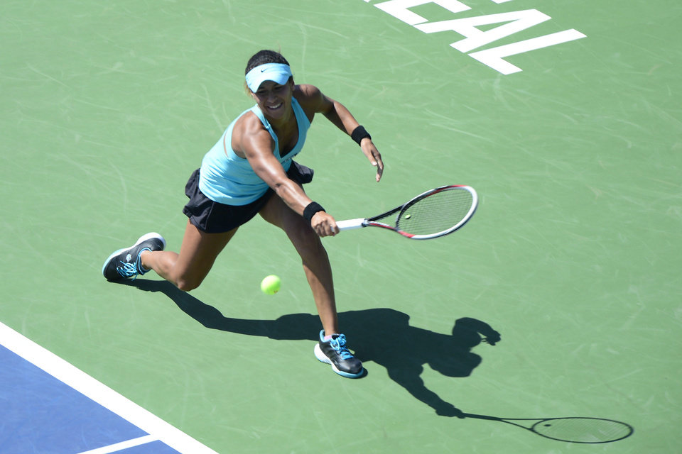 Photo - Heather Watson, of Britain, returns to Dominika Cibulkova, of Slovakia, during second round play at the Rogers Cup tennis tournament in Montreal on Wednesday, Aug. 6, 2014. (AP Photo/The Canadian Press, Paul Chiasson)