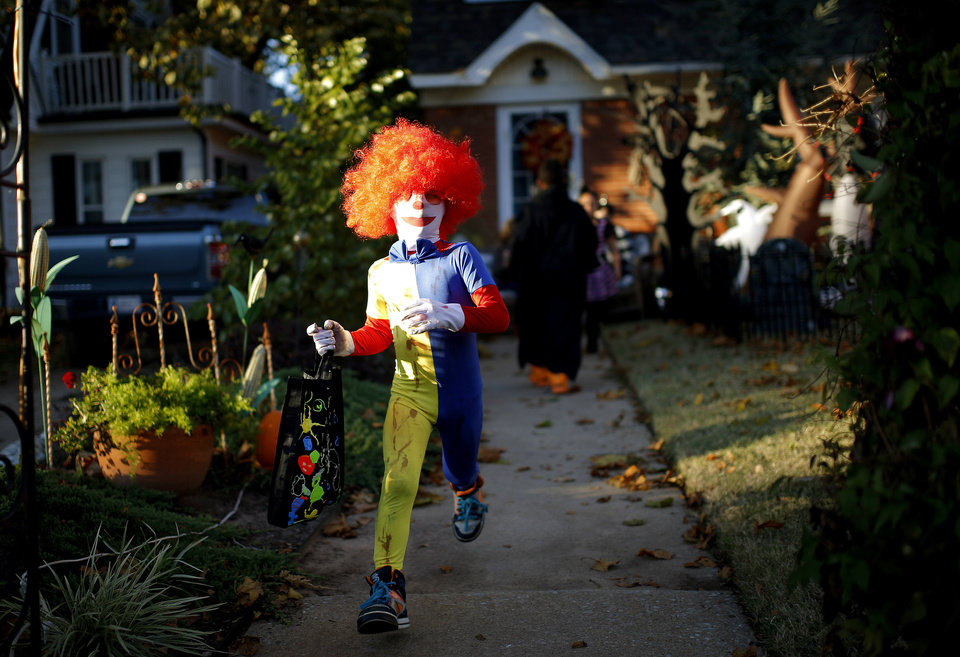 Photo - Kaisaiah Stidham, 6, leaves a home on 19th Street as while trick-or-treating on Halloween in Oklahoma City, Thursday, October 31, 2013. Photo by Bryan Terry, the Oklahoman