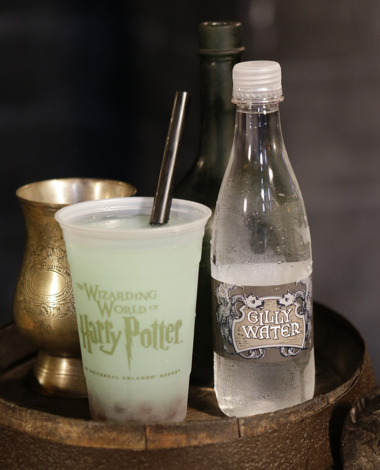 Photo - Fishy Green Ale and Gilley Water are some of the beverages available at the Leaky Cauldron during a preview of Diagon Alley at the Wizarding World of Harry Potter at Universal Orlando, Thursday, June 19, 2014, in Orlando, Fla. (AP Photo/John Raoux)