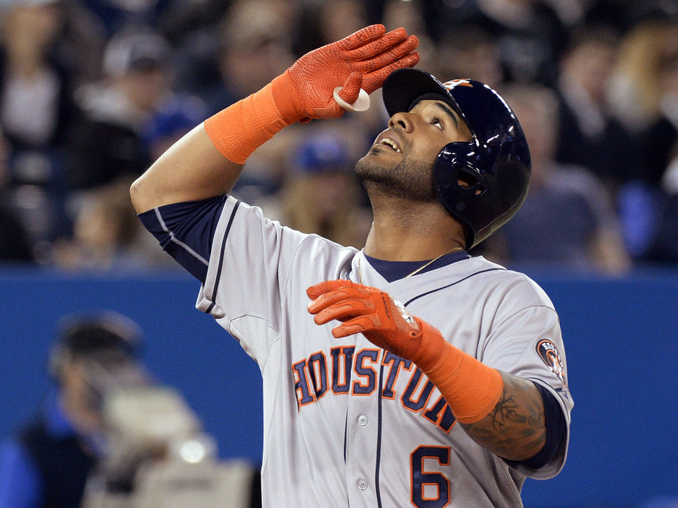 Photo - Houston Astros' Jonathan Villar salutes after hitting a three-run home run off Toronto Blue Jays starting pitcher R.A. Dickey during the seventh inning of baseball game in Toronto on Thursday, April 10, 2014. (AP Photo/The Canadian Press, Frank Gunn)
