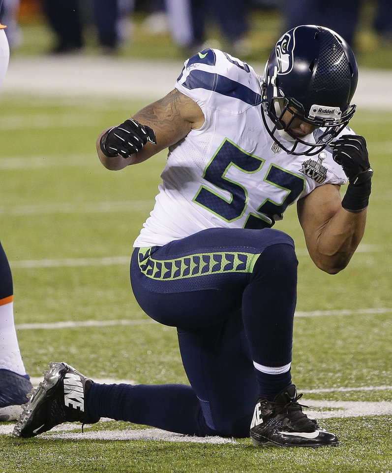 Photo - Seattle Seahawks outside linebacker Malcolm Smith (53) reacts after making a tackle against the Denver Broncos during the second half of the NFL Super Bowl XLVIII football game, Sunday, Feb. 2, 2014, in East Rutherford, N.J. (AP Photo/Gregory Bull)